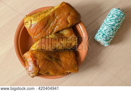 Pork Meat Marinated In Soy Sauce And Spices. Three Large, Appetizing Pieces Of Pork Tenderloin Lie O