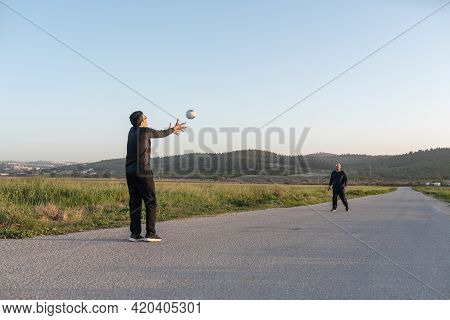 Handball Players Playing Game Outside.senior Father And Teenager Son Playing With Ball On Nature At