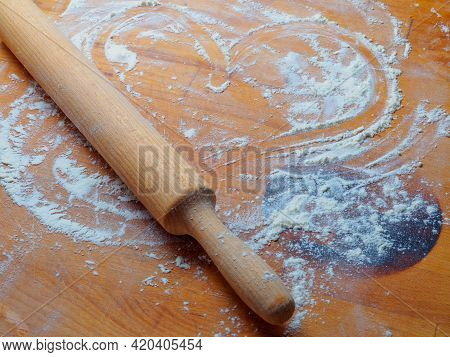 Rolling Pin On A Wooden Table Sprinkled With Flour And A Drawn Heart. Making Baked Goods With Love.