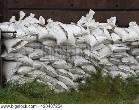 Many White Sandbags Have Been Cut To Pieces By Vandals