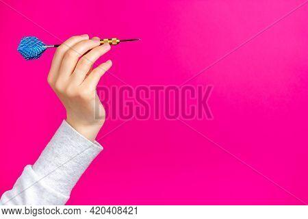 Dart Dart In Hand. Aiming Process. Preparing To Throw A Dart