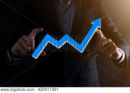 Businessman Man Holding A Graph With Positive Profits Growth. Plan Graph Growth And Increase Of Char