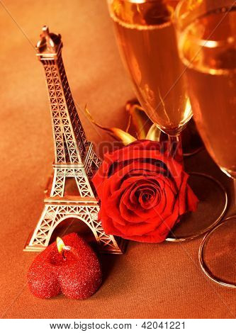 Photo of two glass of champagne on the table in restaurant, festive romantic still life, alcoholic beverage, red rose and candle, wedding day, honeymoon in Paris, travel to France, Valentine day