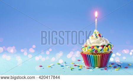 Birthday - Cupcake With Candle And Blue Decoration