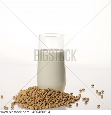 Vegan Soy Milk, Rice Milk, Oat Milk, Dairy-free Alternative Milk And Soybeans. White Background.