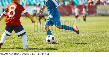Children Playing The Game On Football Soccer Stadium Field. Boys Compete During A Soccer Tournament