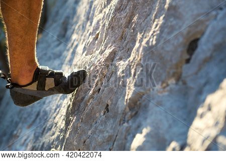 Climbing Shoes On The Climber\'s Foot Rest The Toe On The Rock. Extreme Sports, Mountain Tourism. Cl