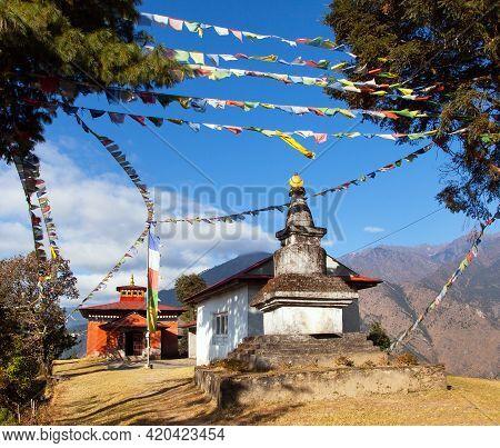 Bupsa Buddhist Gompa Monastery And Stupa With Prayer Flags Near Lukla And Kharikhola Village, Khumbu