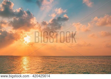 Sunset Sea Landscape. Colorful Ocean Beach Sunrise. Beautiful Beach Scenery With Calm Waves And Soft