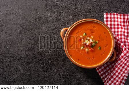 Gazpacho Soup In Crock Pot And Ingredient On Black Slate Background. Top View. Copy Space