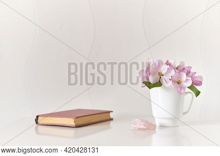 Interior Composition. Gentle Bouquet Of Pink Apple Tree Flowers In A White Coffee Cup, Pink Mineral,