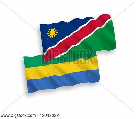 National Fabric Wave Flags Of Republic Of Namibia And Gabon Isolated On White Background. 1 To 2 Pro