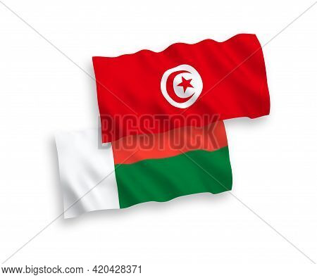 National Fabric Wave Flags Of Republic Of Tunisia And Madagascar Isolated On White Background. 1 To