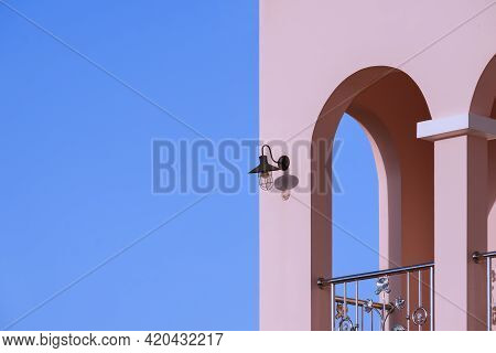 Perspective Side View Of Arches Wall On Balcony Of Modern House Building In Tuscany Style Against Bl