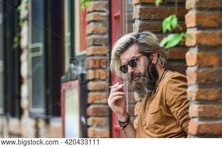 Brutal Mature Hipster Smoking Cigarette. Bad Habits Concept. Harmful For Your Health. Smoke Nicotine