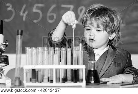 Education Concept. Experimenting With Chemistry. Talented Scientist. Boy Test Tubes Liquids Chemistr