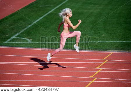 Never Give Up. Marathon. Energetic And Sporty. Sexy Fitness Woman In Sportswear. Athletic Lady Run O