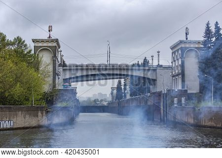 Old Gateway On The Moskva River In Cloudy Rainy Weather. Russia