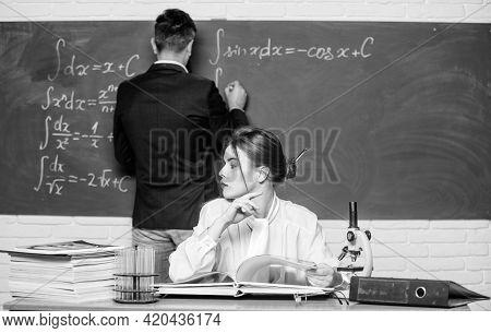 Teaching In University. University Education. Knowledge Transfer. Teacher And Student Near Chalkboar