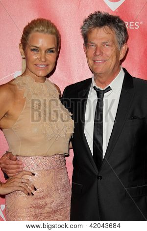 LOS ANGELES - FEB 8:  Yolanda Hadid, David Foster arrives at the 2013 MusiCares Person Of The Year Gala at the Los Angeles Convention Center on February 8, 2013 in Los Angeles, CA