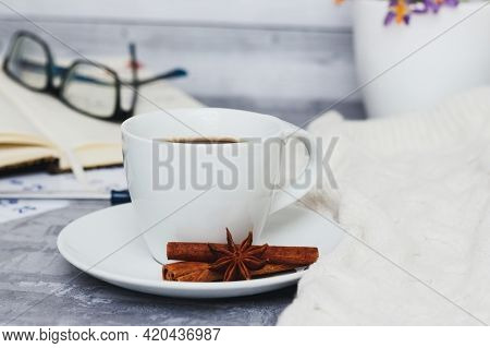 Business Still Life With Cup Of Black Coffee And Notepad