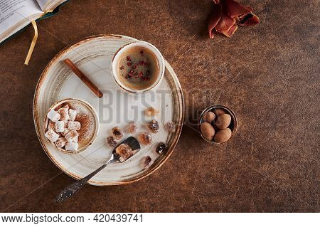 Flat Lay Homemade Two Cups Of Coffee With Marshmallow And Raspberries With Cinnamon On Light Plate W
