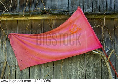 The Union Of Soviet Socialist Republics Flag Waving On A Wooden Background