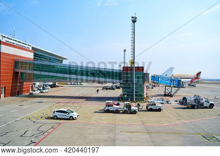 Airplane Parking Near The Airport Terminal. Kyiv, Ukraine - 03.16.2021