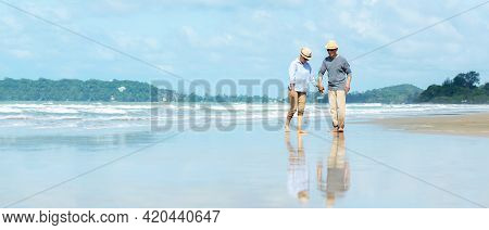 Asian Lifestyle Senior Couple Walking Chill On The Beach Happy In Love Romantic And Relax Time After