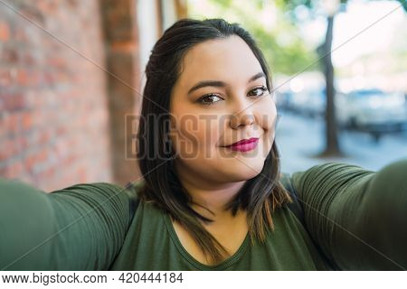 Young Plus Size Woman Taking A Selfie.