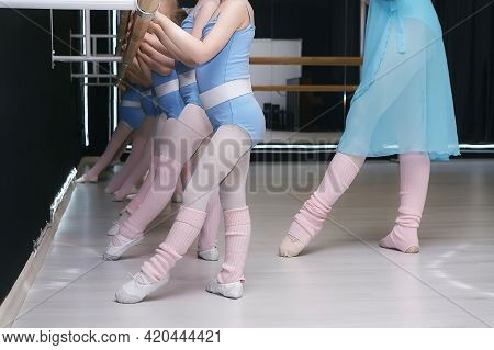 Lesson In The School Of Choreography School. Little Girls Repeat The Movements Of The Teacher.