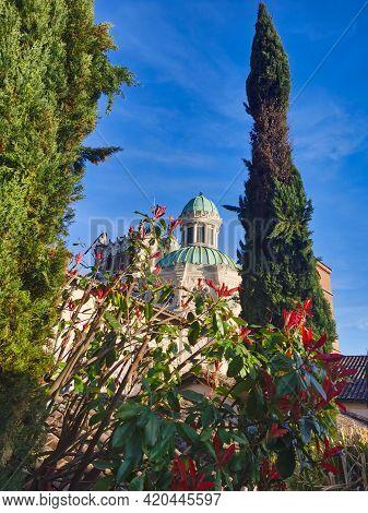 Exterior View Of The Basilica Of Ars-sur-formans. Catholic Church, Village Of Saint Jean-marie Viann