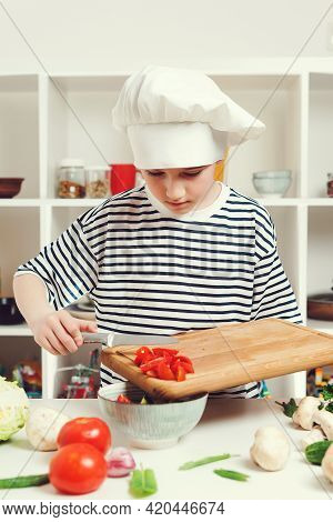 Cute Boy Cook Healthy Dinner For Family. Boy Wearing Chef Uniform And Hat. Kid Want To Be Profession