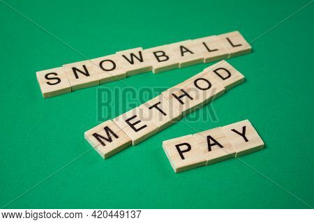 Snowball Method Pay Off Debt. Text Snowball Method Pay Made By Wooden Blocks. Financial Concept.