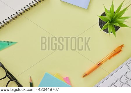 Top View Or Flat Lay Modern Office Desk Or Office Table With Stationery As Keyboard,pen,stick Note,p