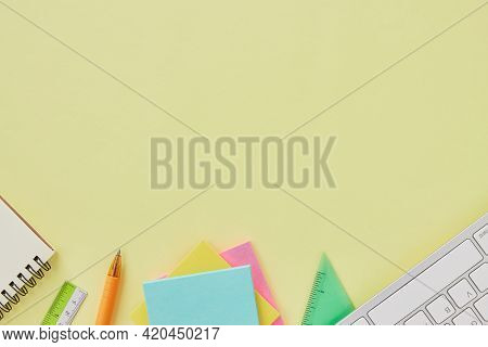 Top View Or Flat Lay Modern Office Table Or Office Desk With Stationery As Keyboard,ruler,stick Note