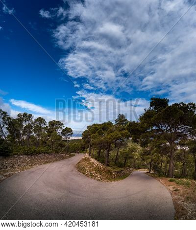 Spectacular U-shape Curved Mountain Road With Cyclist