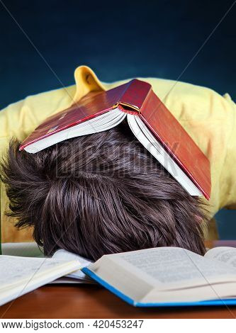 Tired Student Sleep On The Books In The Room Closeup