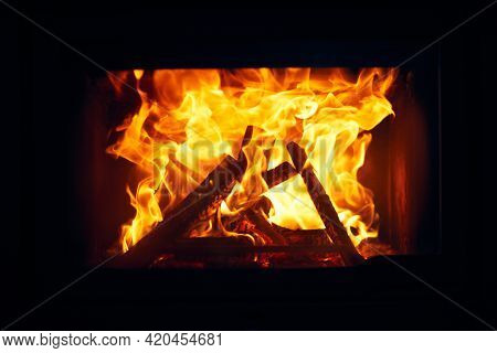 Fire Burns In A Fireplace, Fire To Keep Warm. Logs Burning In
