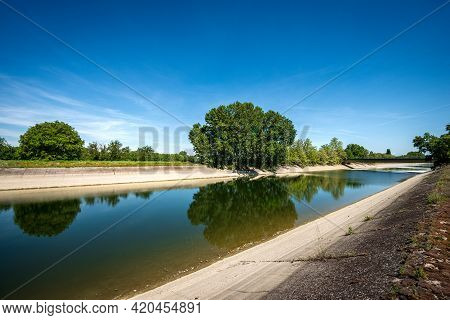 Reinforced Concrete Irrigation Canal Of The River Mincio In The Padan Plain Or Po Valley (pianura Pa
