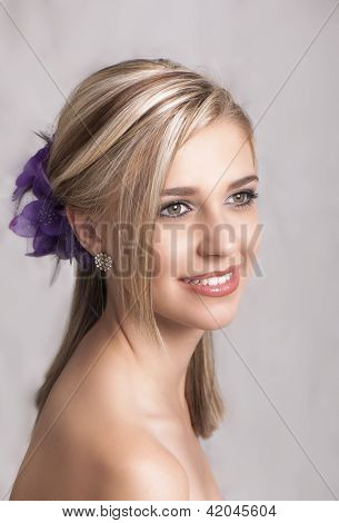 Beautiful smiling blonde woman with hair clip