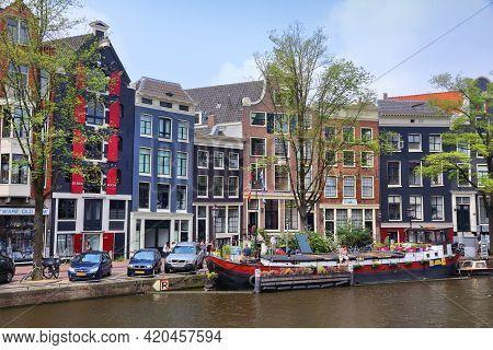 Amsterdam, Netherlands - July 7, 2017: People Visit Prinsengracht Canal In Amsterdam, Netherlands. A