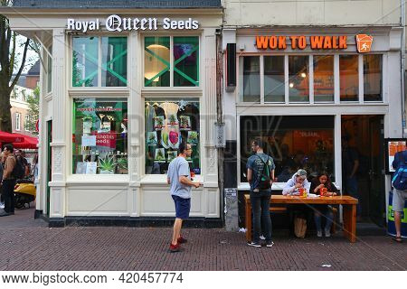 Amsterdam, Netherlands - July 8, 2017: People Visit Cannabis Seed Shop In Amsterdam. Netherlands Has