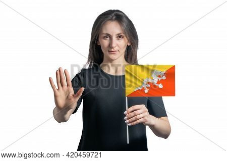 Happy Young White Woman Holding Flag Of Butane And With A Serious Face Shows A Hand Stop Sign Isolat