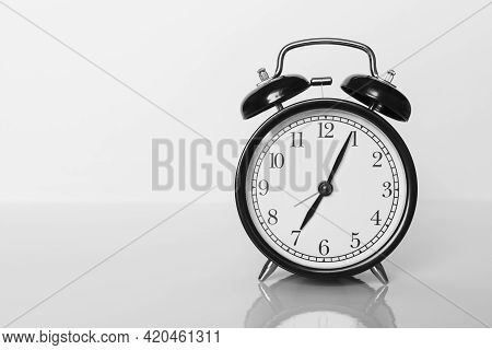 Classic Black Alarm Clock On White Background. Time Concept.