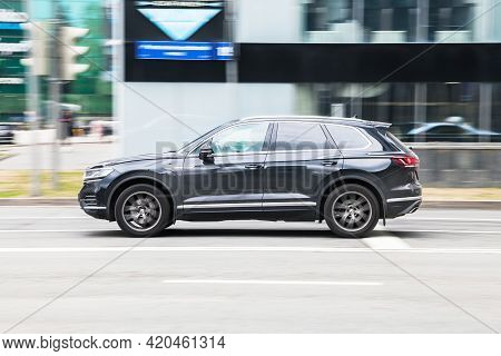 Black Volkswagen Touareg Cr On The City Street In Motion. Fast Moving Car On The Street. Suv Driving