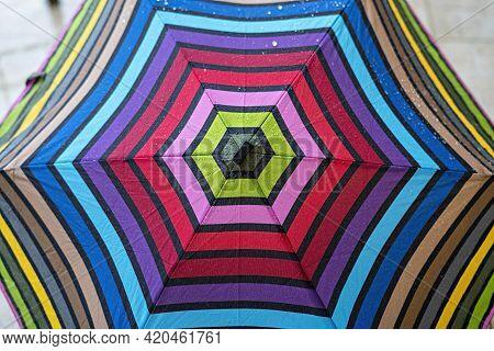Multicolor Umbrella Close-up In Drops Of Rain, Rainbow Pattern