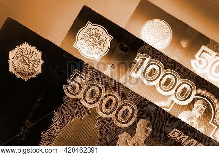 Russian Banknotes 5000, 1000 And 500 Rubles Close-up. Dark Dramatic Black And Brown Illustration Abo