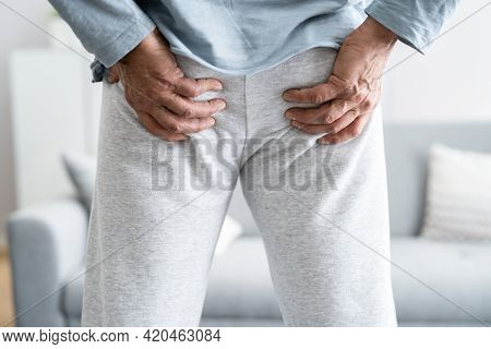 Hemorrhoid Pain, Diarrhea And Constipation. Buttocks Trouble