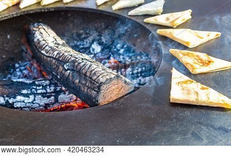 Appetizing Traditional Uzbek Pies Cooking Outdoors. Asian Cuisine. Concept Of National Fastfood Cuis